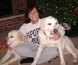 Kathy posing with her current guide dog, Solomon, and her retired guide, Jethro