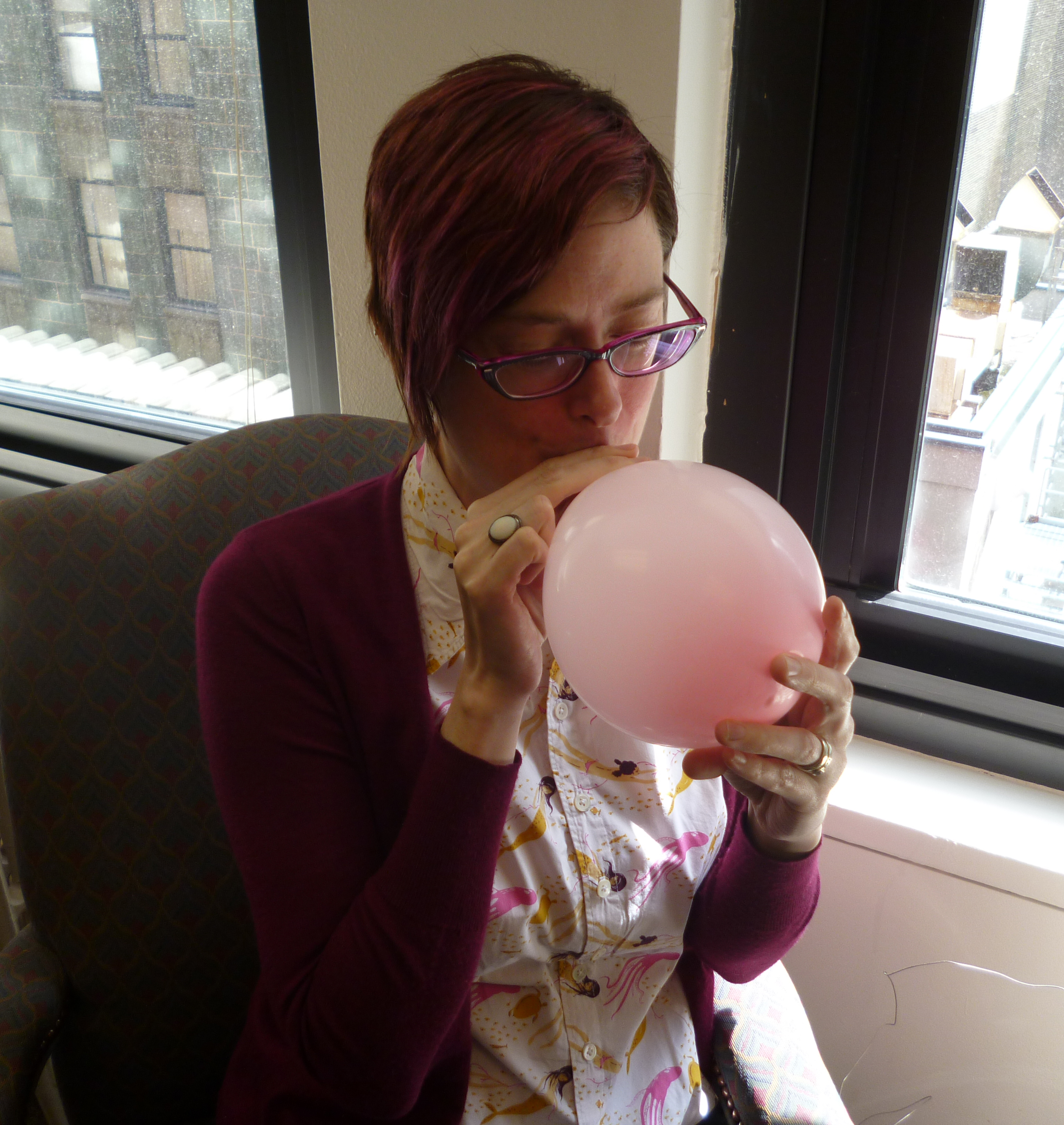 Polly blowing up a balloon 2 cropped