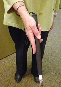 "Kathy demonstrates the ""Baby Bird"" grip Alex taught her"