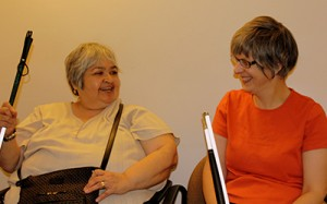Gina and Barbara smiling at each other