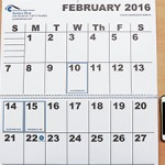 Wall Calendar is coil bound in the center and lays flat with large print dates
