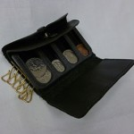 Coin purse with coins in separate slots