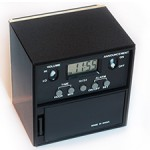 NFB Cube Clock is a black cube with a small LED time display. Has five buttons to set features.