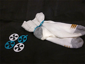 Round sock sorters grouped together and holding a pair of socks
