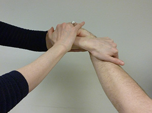 Polly demonstrating one of the 1-Touch hand positions she learned