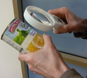 Using a magnifier to read a can label