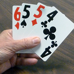 Cribbage hand with large print playing cards