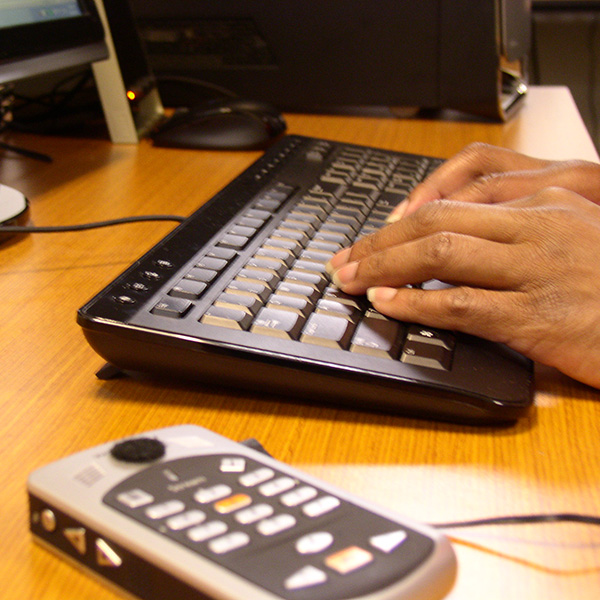 Hands on keyboard with Victor Reader Stream for notes
