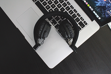 Computer keyboard and headphones