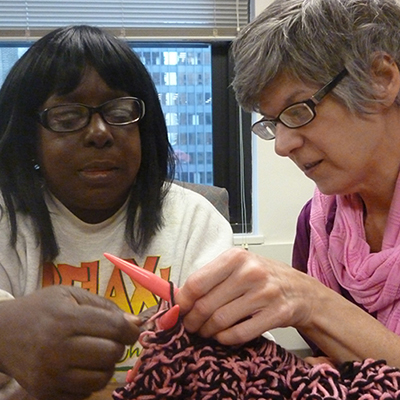 Gina leads our knitting group