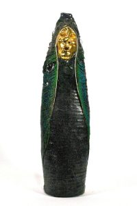 A golden-faced figure with a black and green body.