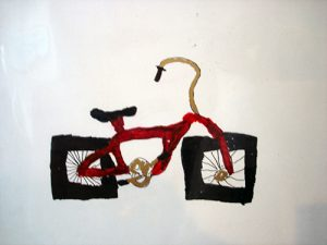 A red bicycle with two square wheels