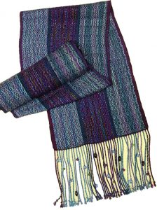 A scarf woven in multiple shades of blues, greens and purple.