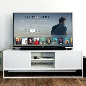 A television with a movie streaming site open and Gone Girl the current selection