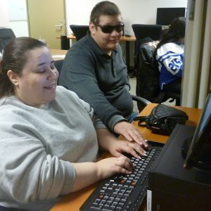 Jose works with Jocelyn in the Open Computer Lab