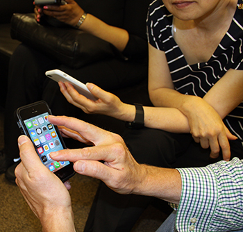 Group of people using apps on their iPhone