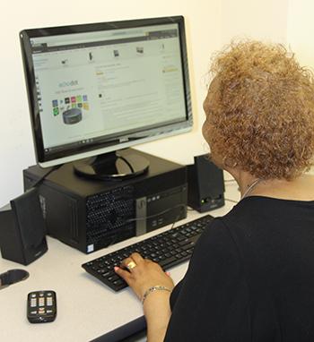 Charlotte at computer using Cortana