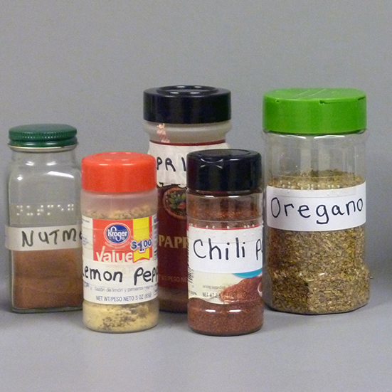 spices with large print and braille labels