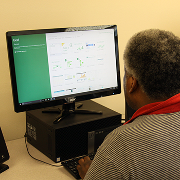 Client using Excel on a computer in our training lab