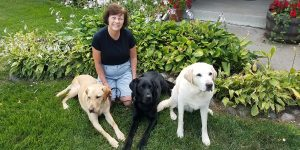 Kathy with her three guides, past and present, Rowen, Weller and Solomon.