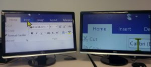 Two monitors, one showing magnification set at 6X and the other at 12X.
