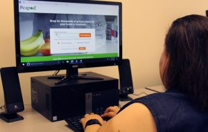Jocelyn sits at a computer exploring Peapod's website