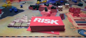 Risk game board showing armies in Africa and the card deck in the foreground