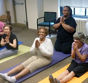 Marilyn leads a yoga class at Second Sense