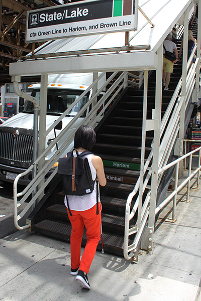 Andrea uses her cane to find the bottom stair at the 'L' station.