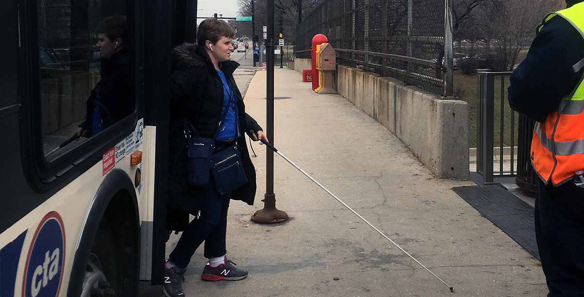 Kira exits a CTA bus on the first let of her journey